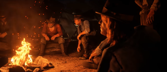 Characters huddled around a campfire paying attention to someone off screen